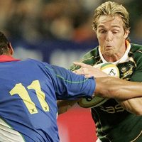 CAPE TOWN, SOUTH AFRICA - AUGUST 15:  Percy Montgomery of South Africa stopped by Melrickduring the RWC warm up match between South Africa and Namibia held at Newlands Stadium on August 15, 2007 in Cape Town, South Africa. Montgomery played his last test on home soil. (Photo by Tertius Pickard /Gallo Images/Getty Images)